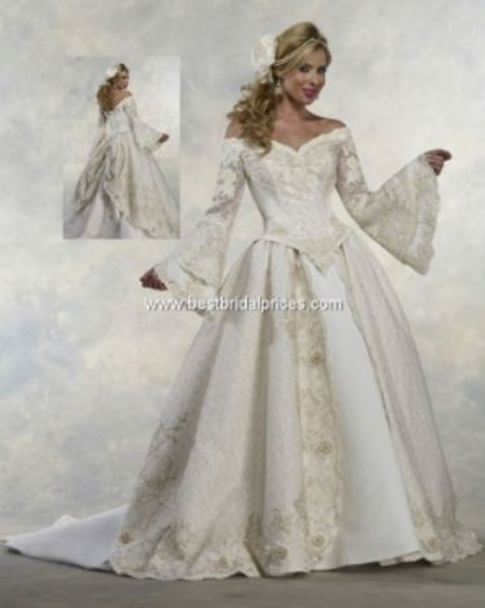 Renaissance satin and lace Wedding dressThe entire dress is covered with gold leaf lace that is embroidered in 3-dimensional flowers. ¾ length lantern sleeves, basque waistline and off-the-shoulder neckline are also heavily embroidered.