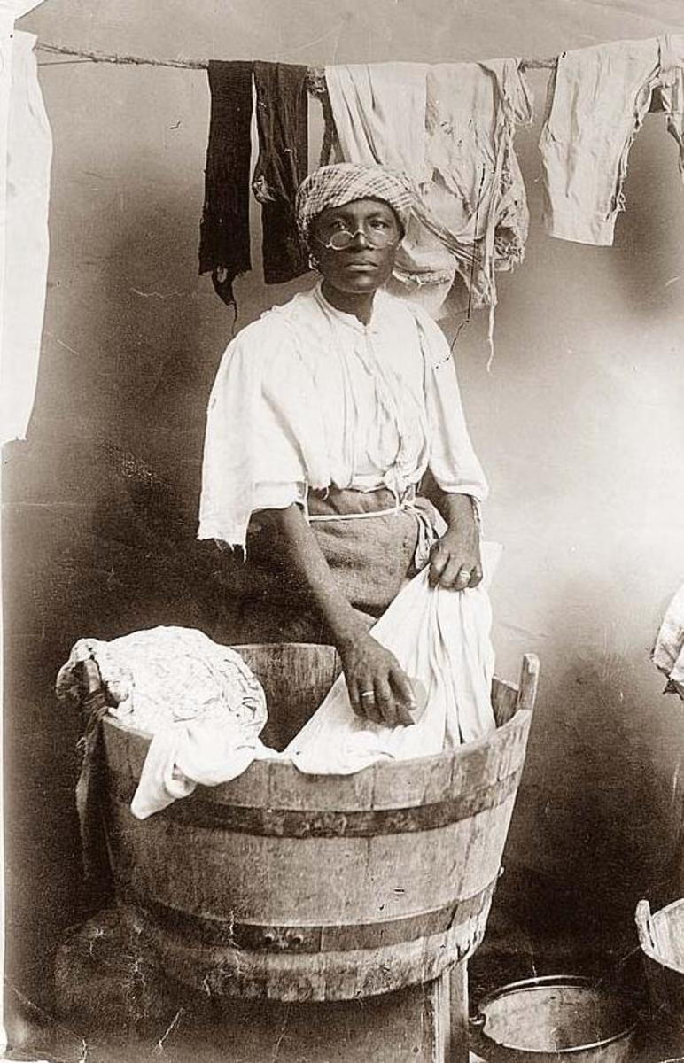 A woman washing her clothes by hand