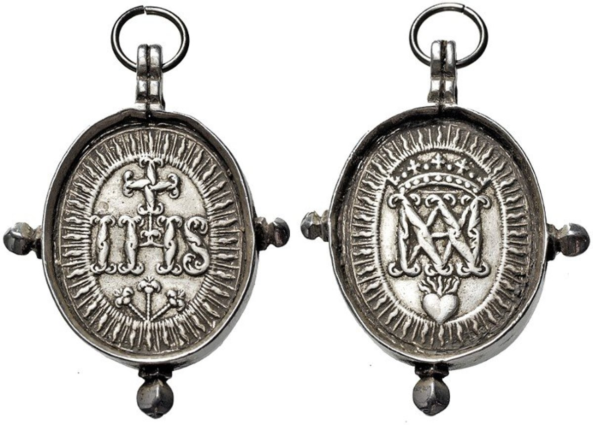 ITALY  High Oval Wallfahrtsmed. o.J. (18th century; Hamerani - Workshop to Roma). Cross over IHS and three nails in Flammengloriole. Rs: Crowned monogram Marie on burning heart in Flammengloriole. In silver band with lifting lug, ring and 3 knobs.