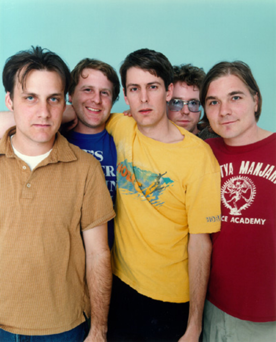 Steve Malkmus, the singer and main songwriter is wearing the yellow shirt.  (image from: www.starpulse.com)