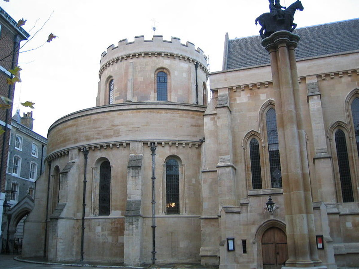 The outside of Temple Church in London, showing the view from the south, and the statute of the Knights Templar in the foreground