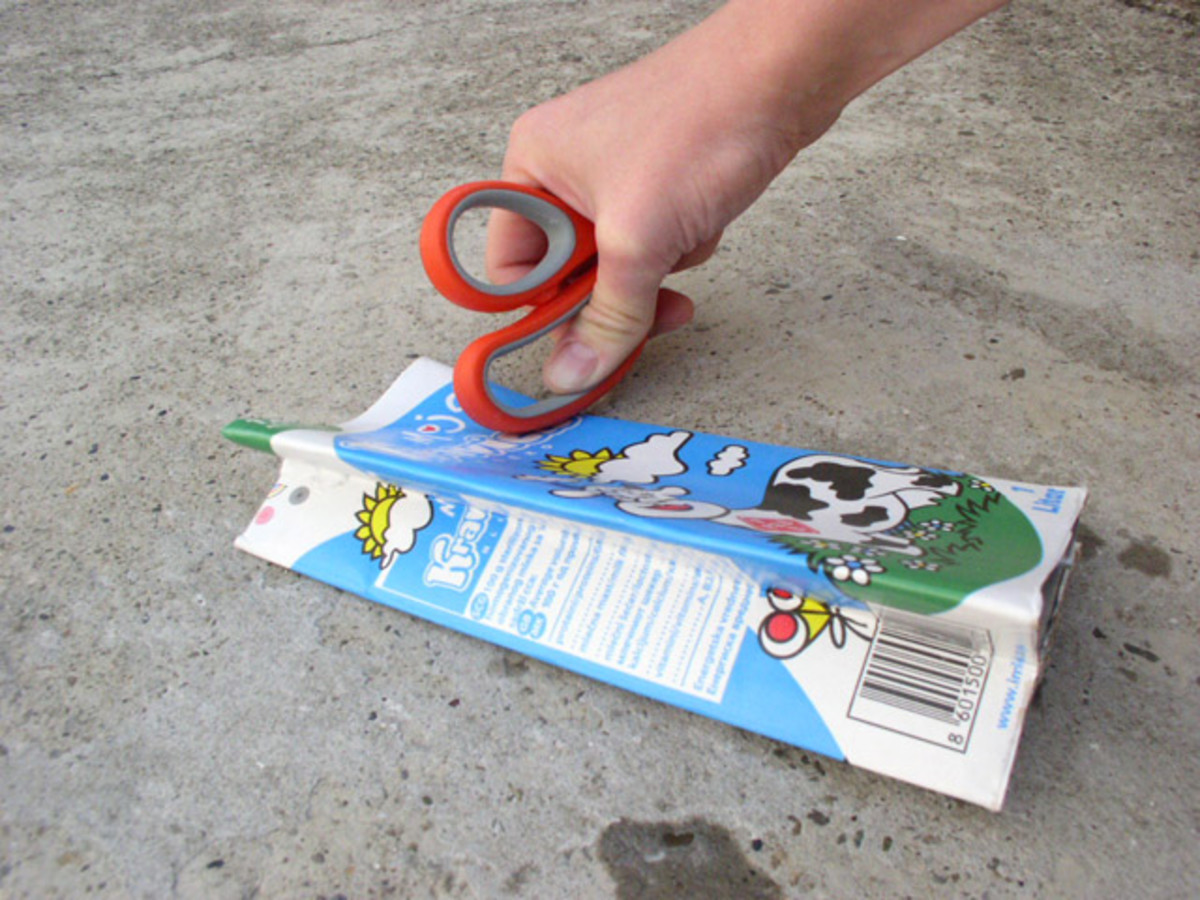Press the scissor on the package and move along the side while you keep the scissors pressed down.