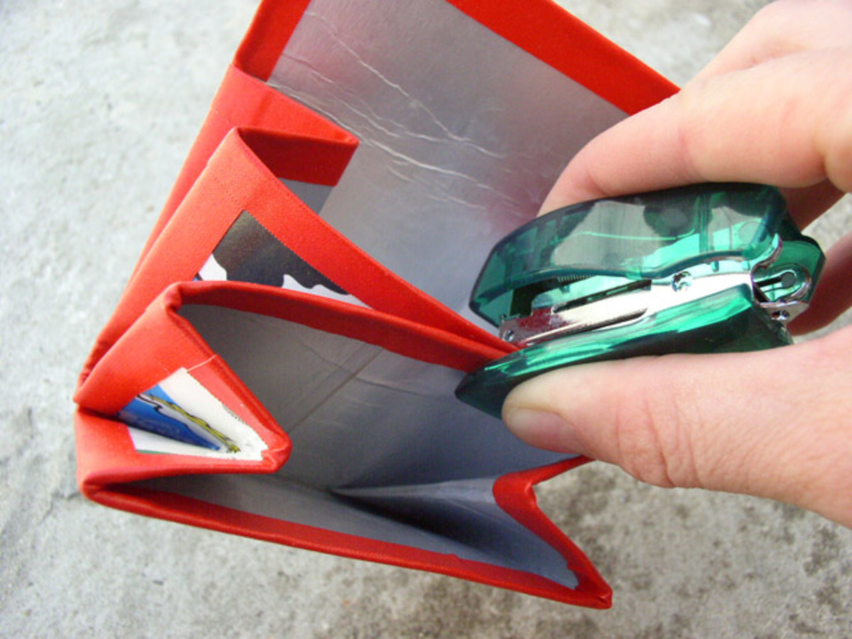 Use a small stapler to connect the pockets together. Put one staple on the right side.