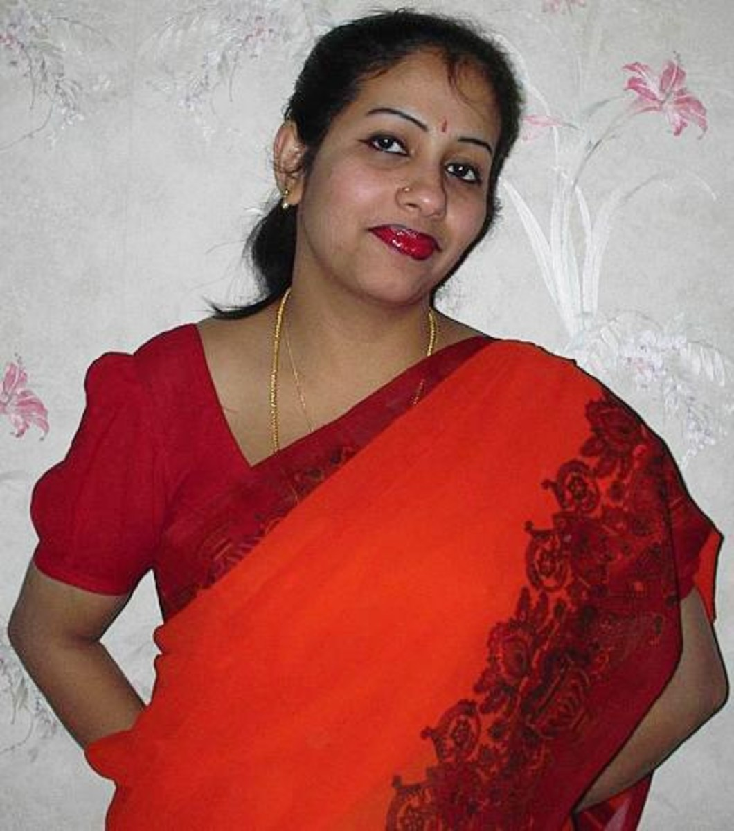 Mrs.Shobha-a housewife from south india, who is beautiful not just because of her features and colour, but also her soft nature, which is obvious in this picture. Such ladies are in large number throughout India