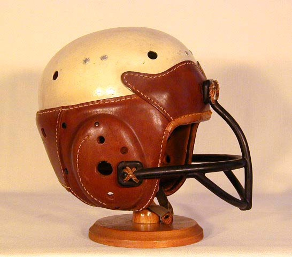 Later in the 30's a face mask was added to reduce injury to the unproteced parts of the head.