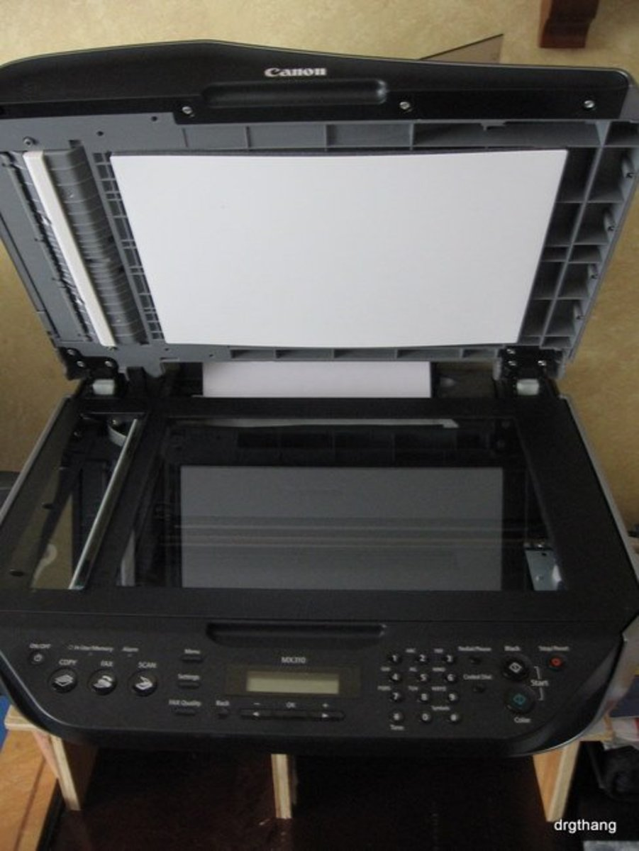 Open the top of the Canon MX310 to reveal the scanning and copying flatbed.