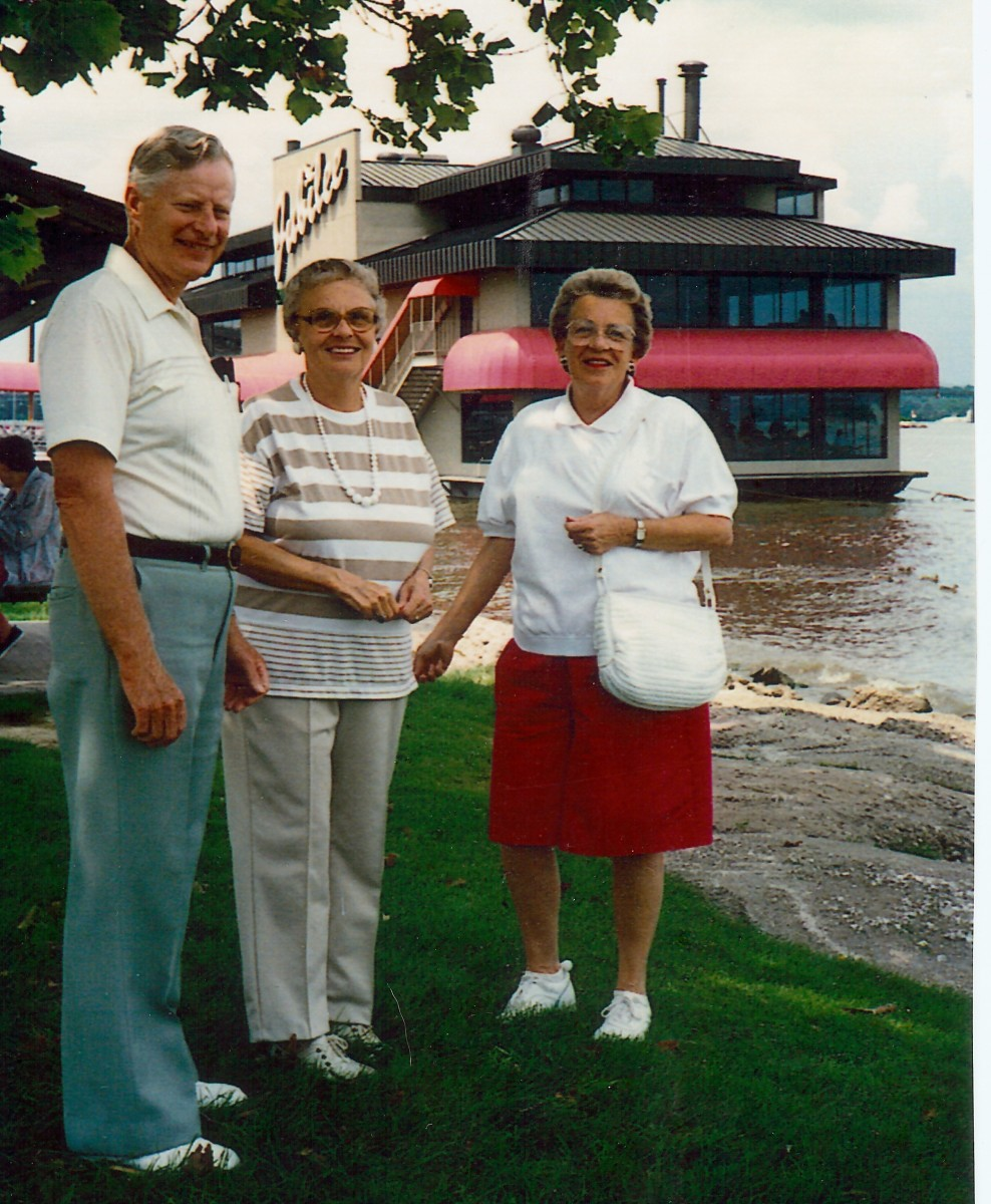 My uncle, aunt & mother with Jubilee restaurant in background on the Mississippi River.
