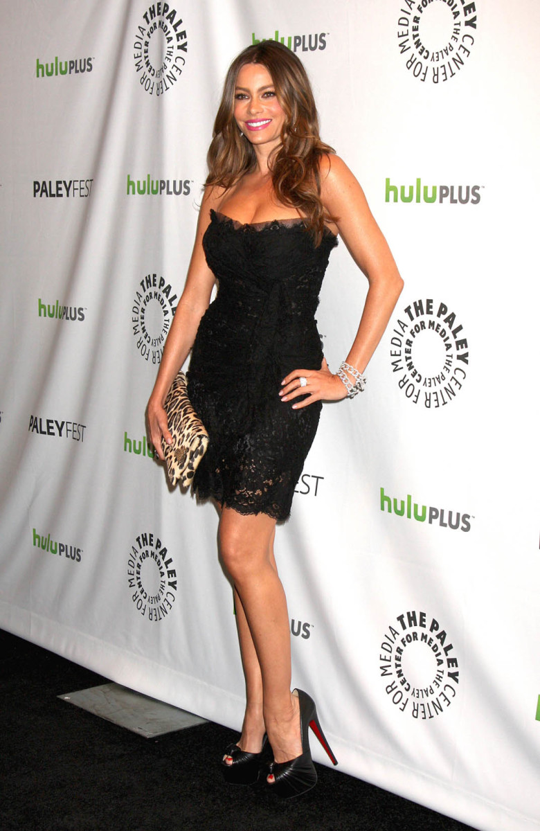 Sofia Vergara is scorching hot in a pretty lace little black strapless dress and Christian Louboutin platform high heels