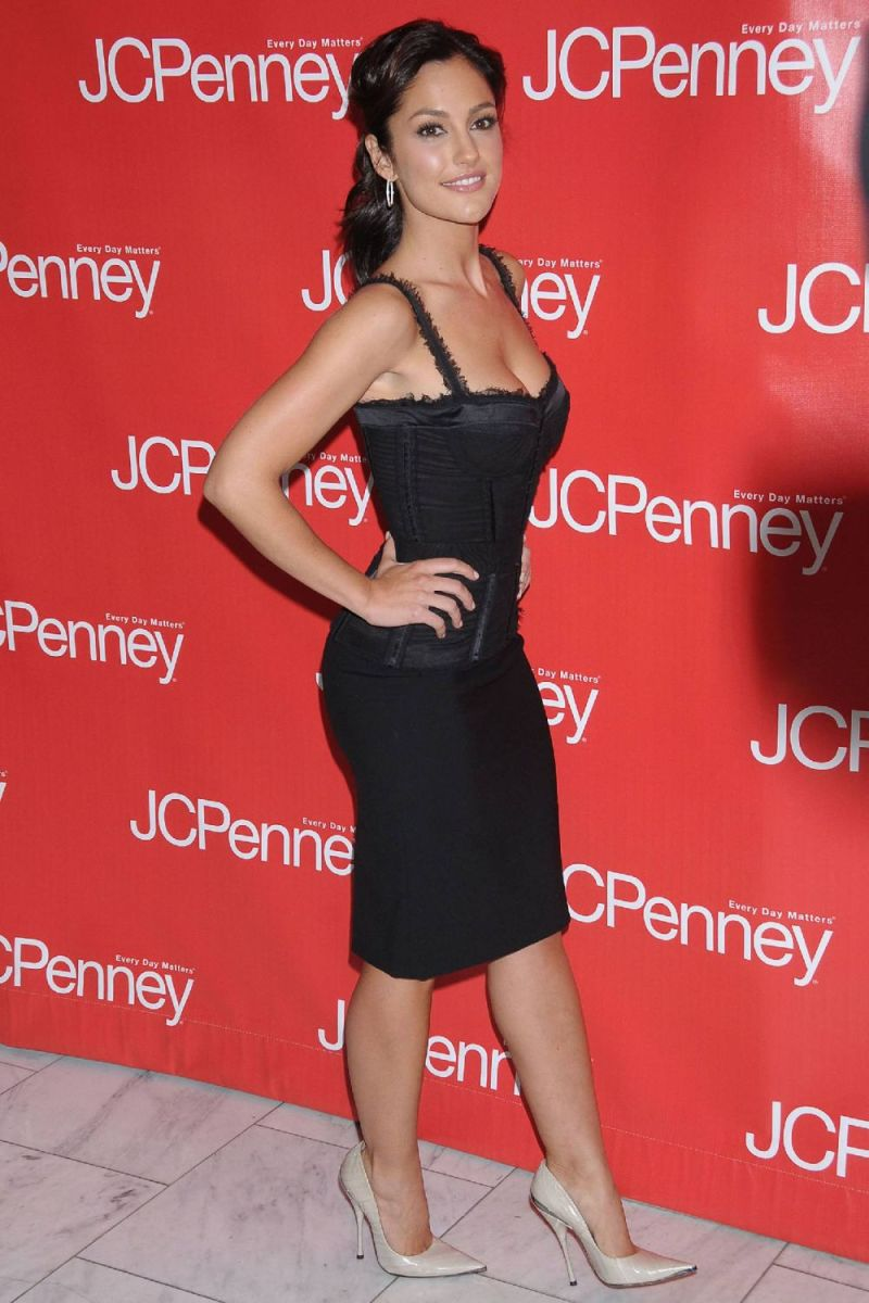 Minka Kelly in towering high heels and a little black dress