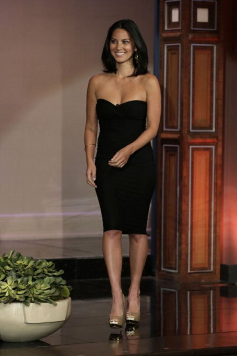 Olivia Munn in a strapless black mini dress appearing on the Tonight Show