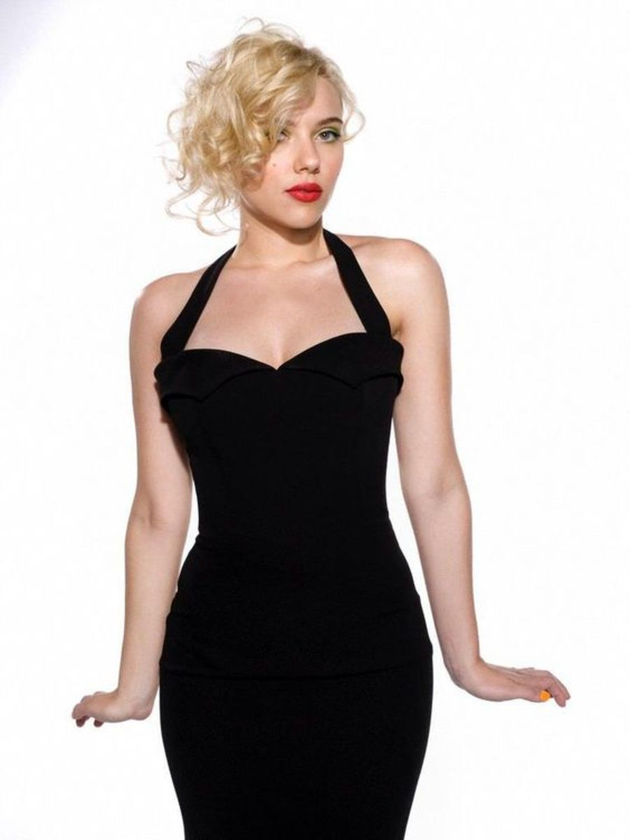 Scarlett Johansson in a curve hugging little black dress