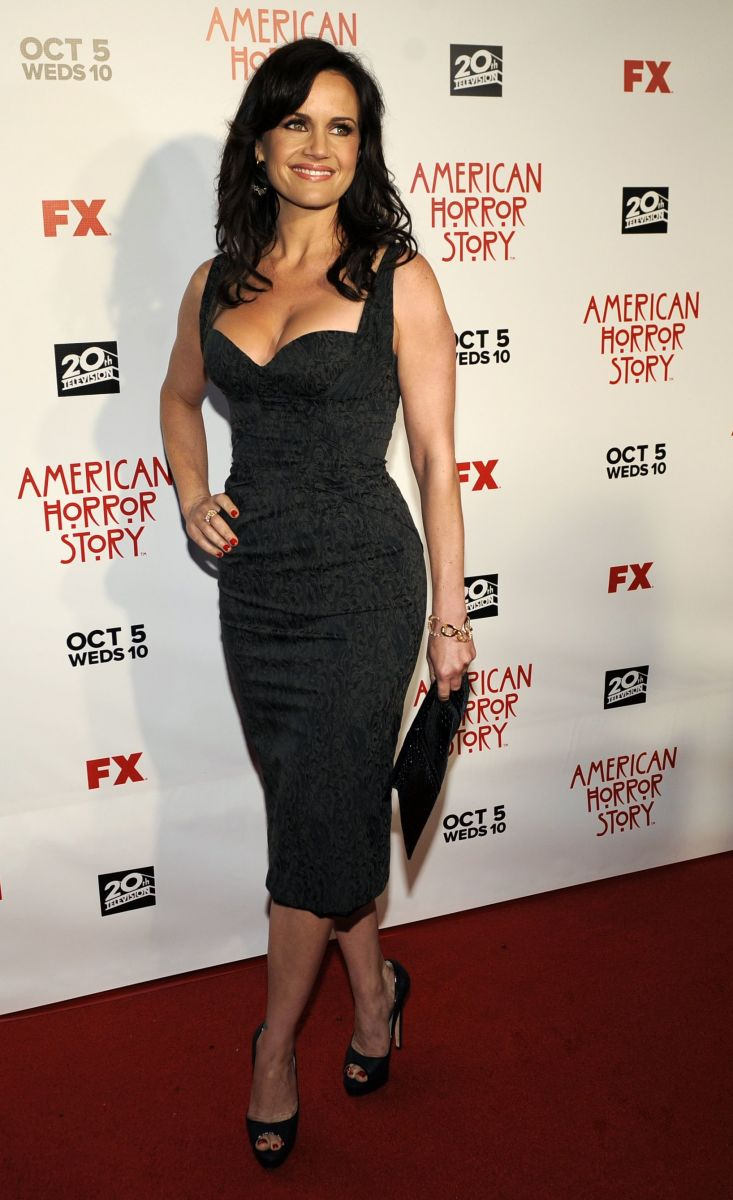 Carla Gugino has great cleavage in a sexy curve hugging little black dress and peep toe platform pumps on the red carpet