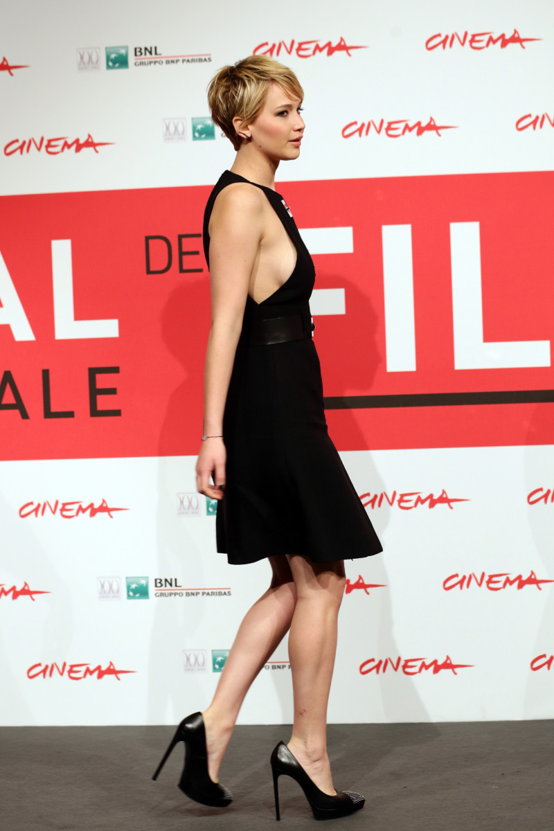 Jennifer Lawrence in a sleeveless little black dress and platform high heels