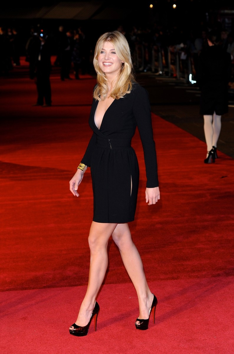 Gorgeous Rosamund Pike working the red carpet in a plunging long sleeved little black dress and peep toe Christian Louboutin platform pumps