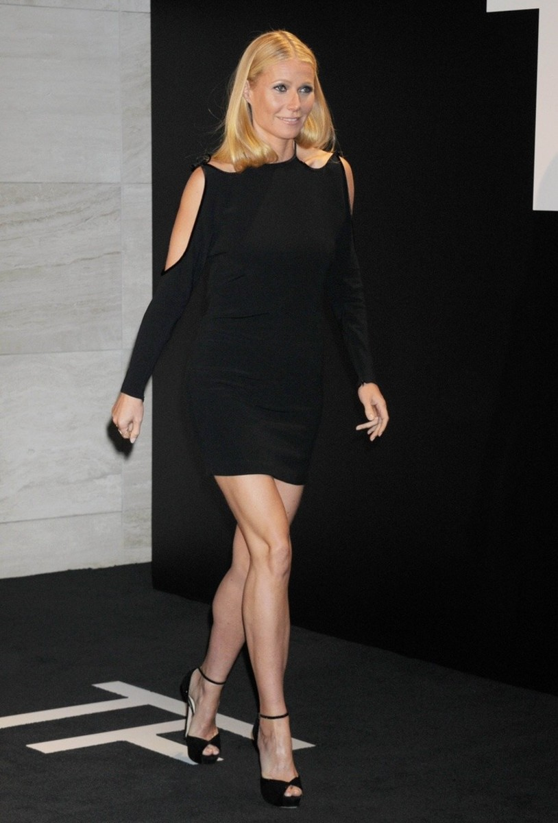 Gwyneth Paltrow in a cut-out little black dress with peep toe platform high heel sandals