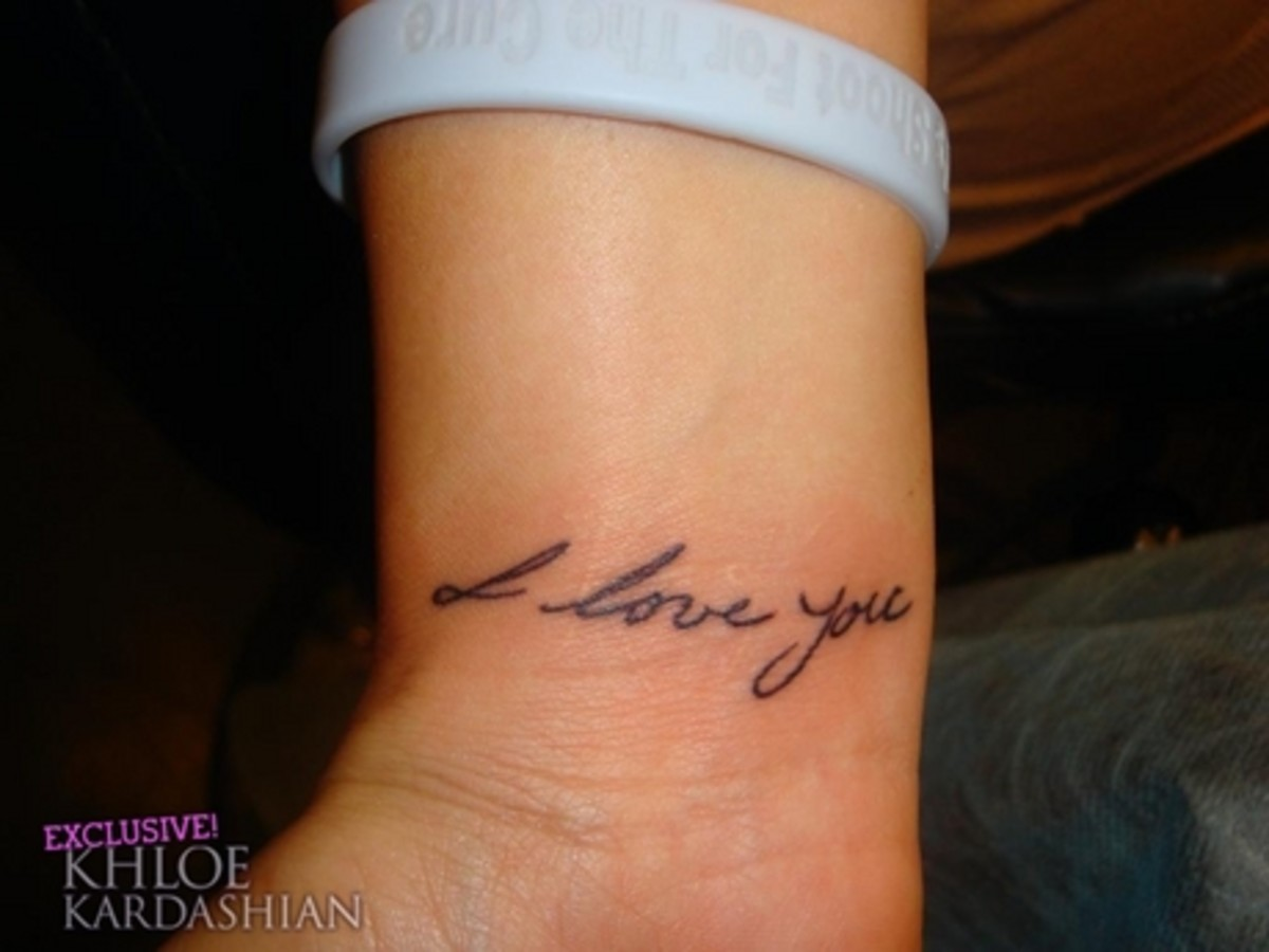 """i love you"" written on the wrist."