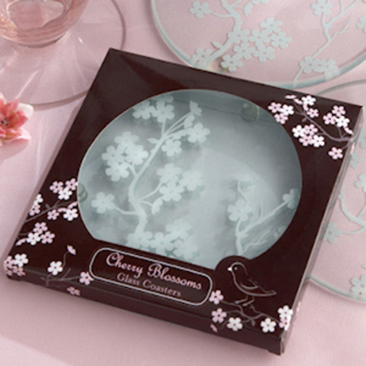 Frosted glass coasters with chocolate and pink cherry blossom packaging.