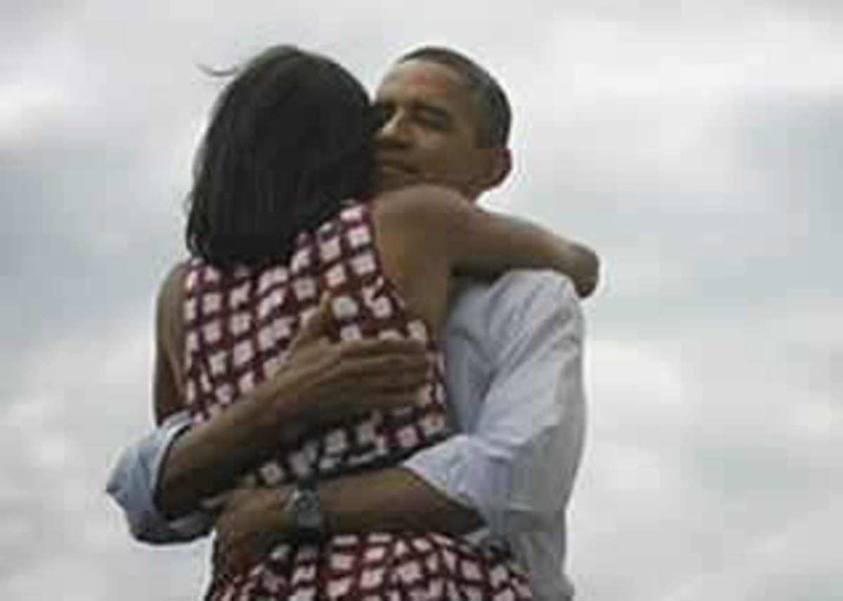 The Best couple in politics if ever there was any- Obama and Mitchell in a true embrace- with all the meanings attached to it... In 2012, Obama was re-elected for the second term in office...