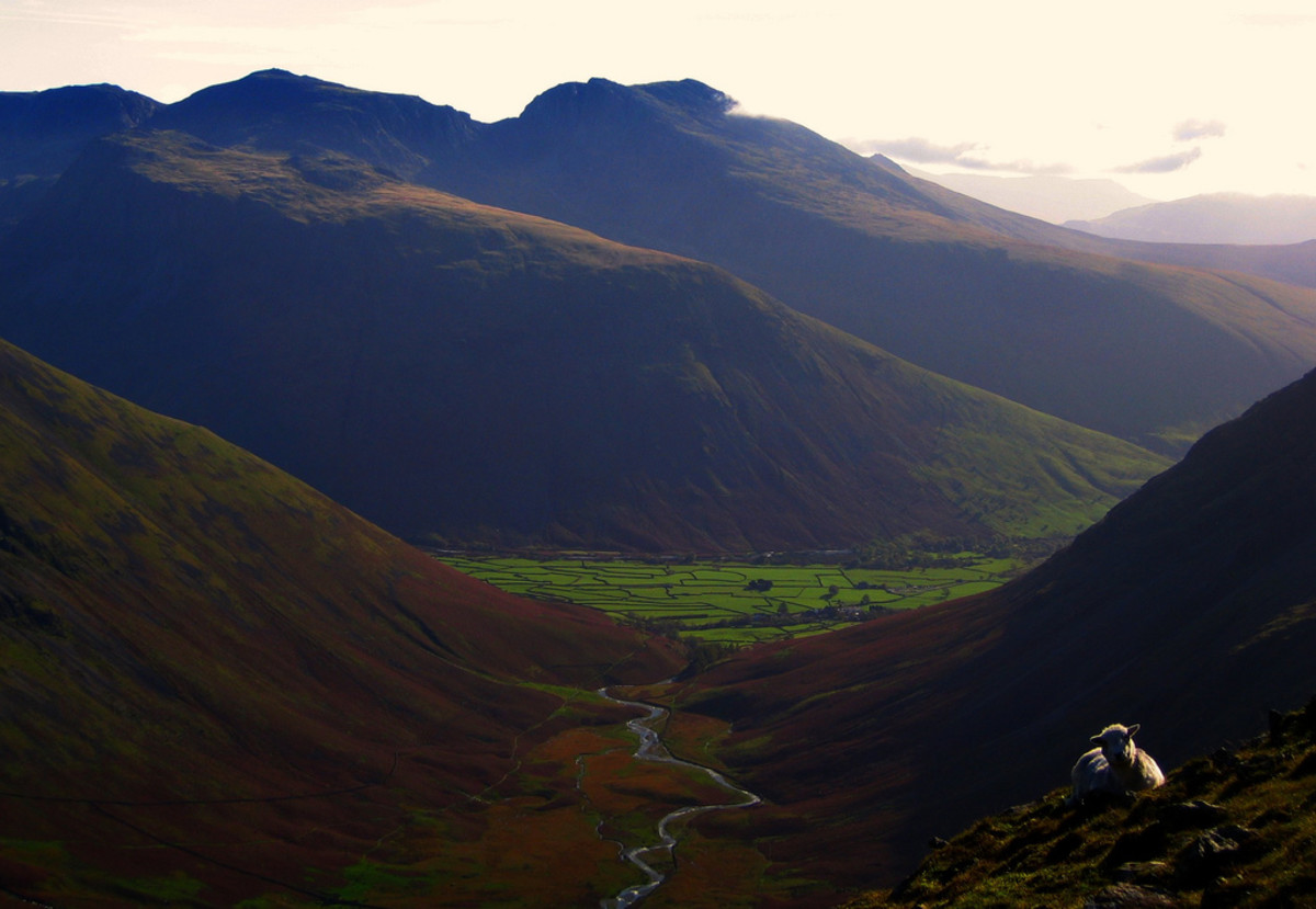 A picture of Scafell Pike which is the highest mountain in England.  This is the highest peak in the distance, second peak in from the left of the shot.  Also included in the picture is the second highest mountain in England, Scafell, at the centre o