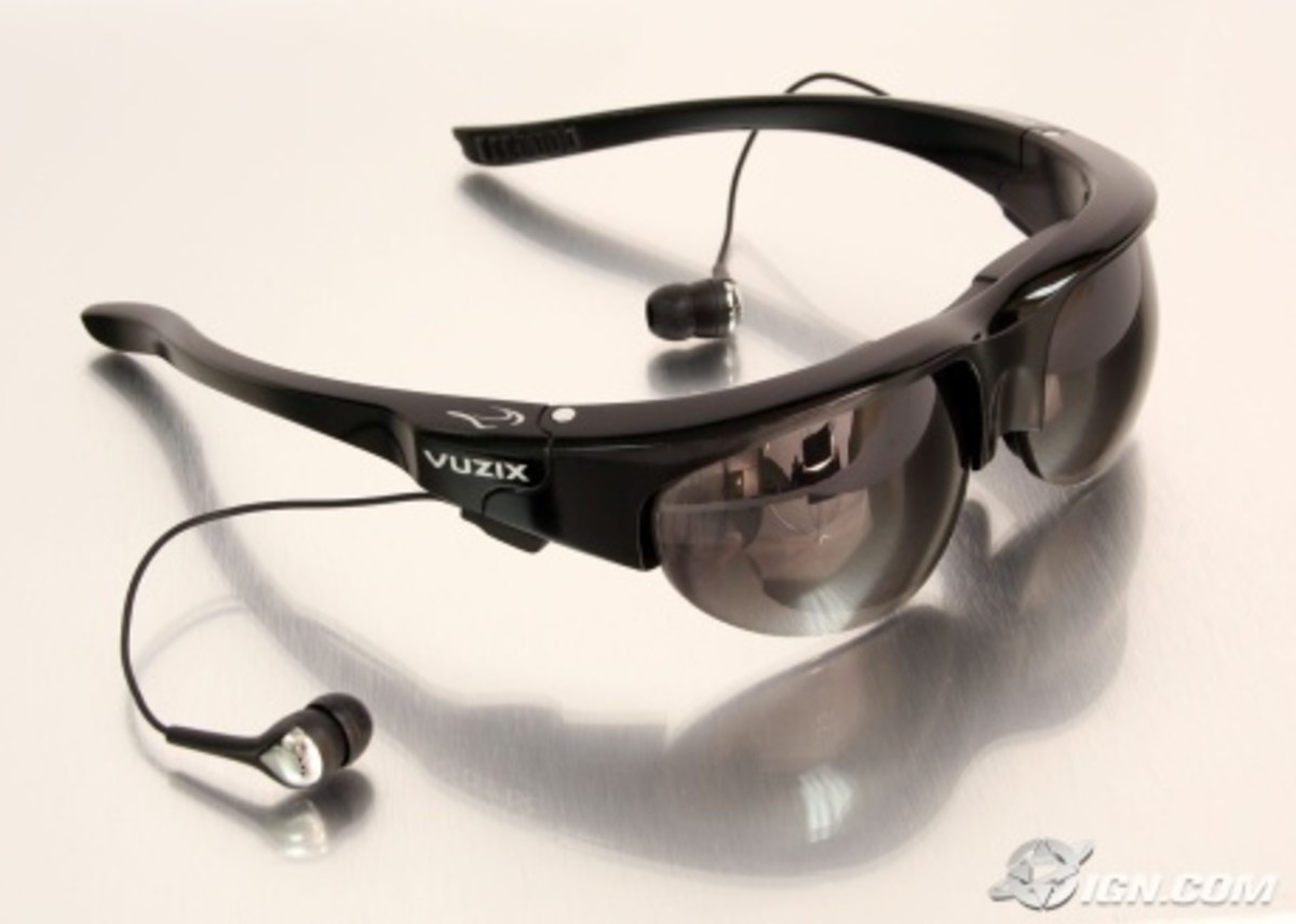 "Virtual reality Sunglasses. ""The Wrap 920AV"" headgear functions as either as sunglasses of portable video eyewear, and can be connected to almost any type of media player; also includes built-in audio for quiet viewing"