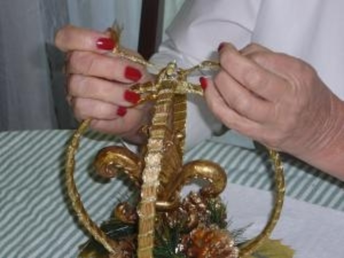 Step 2: If you will be adding an ornament, tie to top joint of mobile or glue.