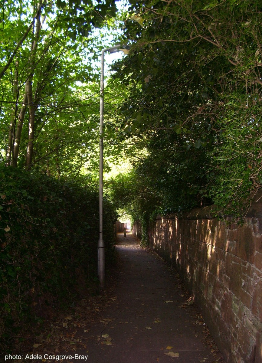 A quiet lane leading from Ashton Park to Grange Road. Either turn left to arrive back at the train station, or cross the road to Darmond's Green.