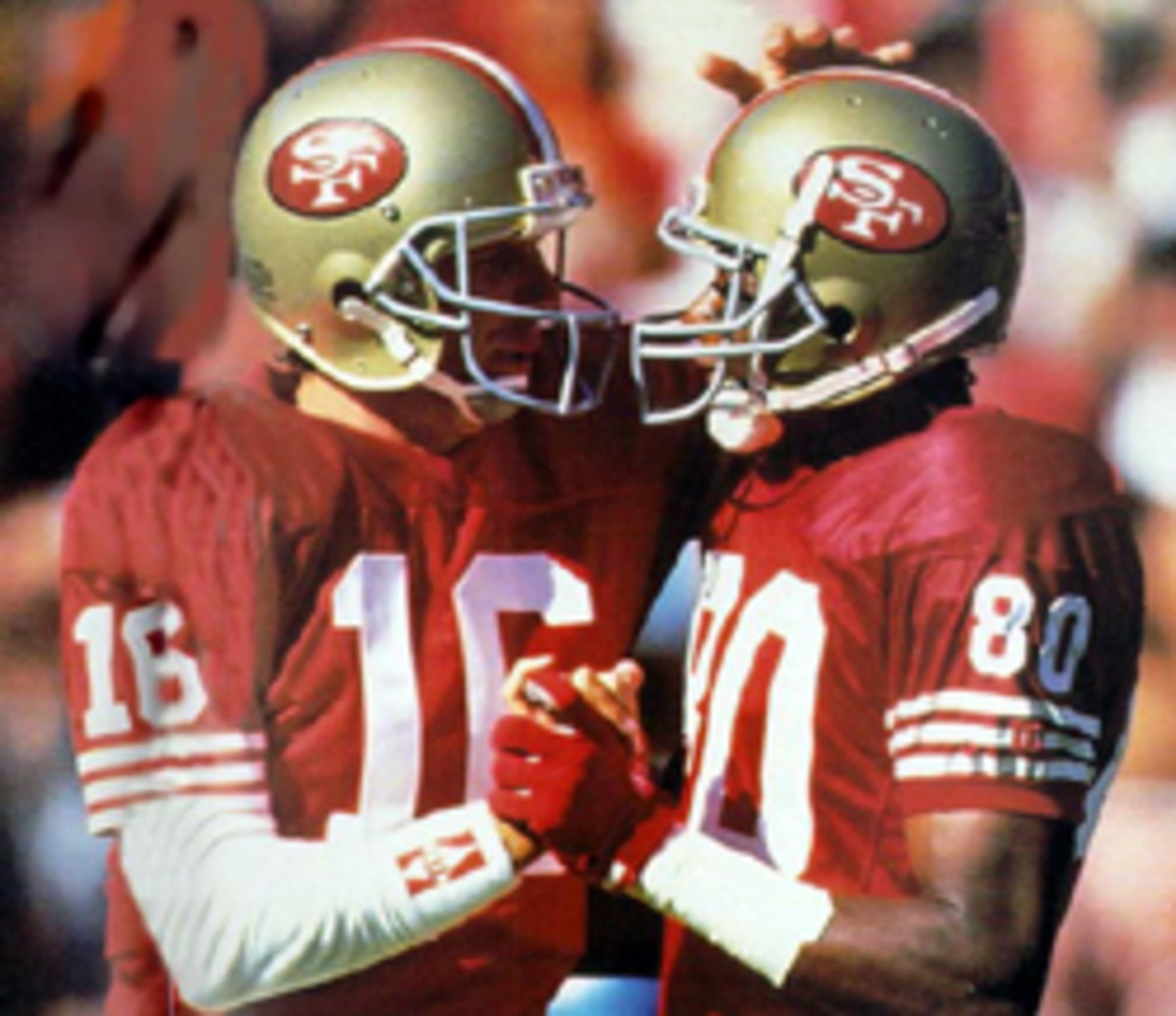 QB Joe Montana (right) and wide receiver Jerry Rice celebrate during Super Bowl XXIV against the Denver Broncos at the Superdome in New Orleans, Louisiana Jan 28,1990