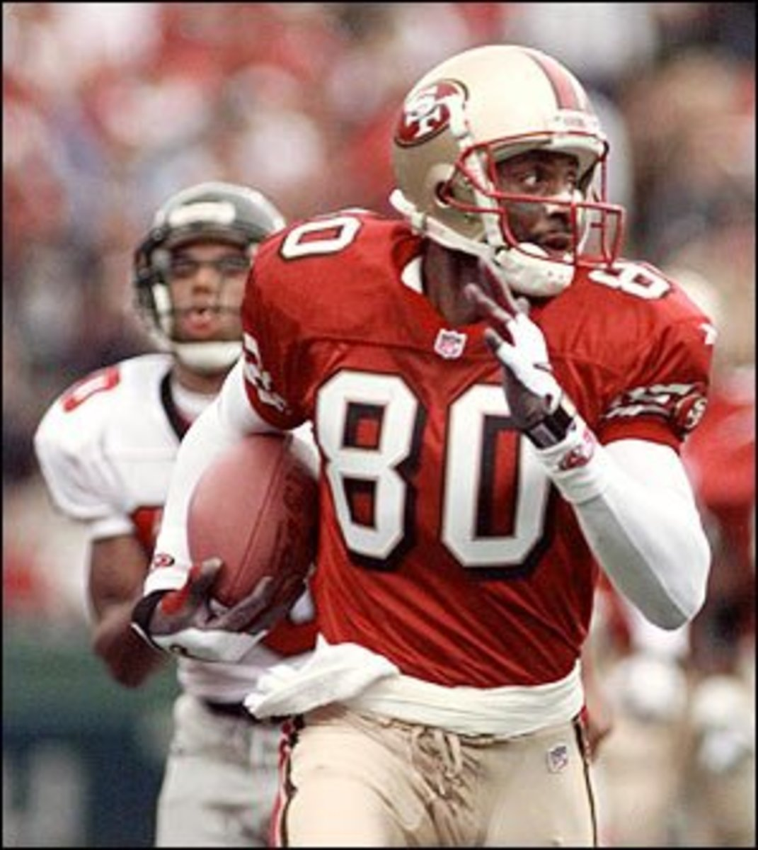 Jerry Rice breaks away from an Atlanta Falcons defender on a 66-yard TD run during the first quarter in playing for the 49 ners in 1998. (Sept. 27, 1998)