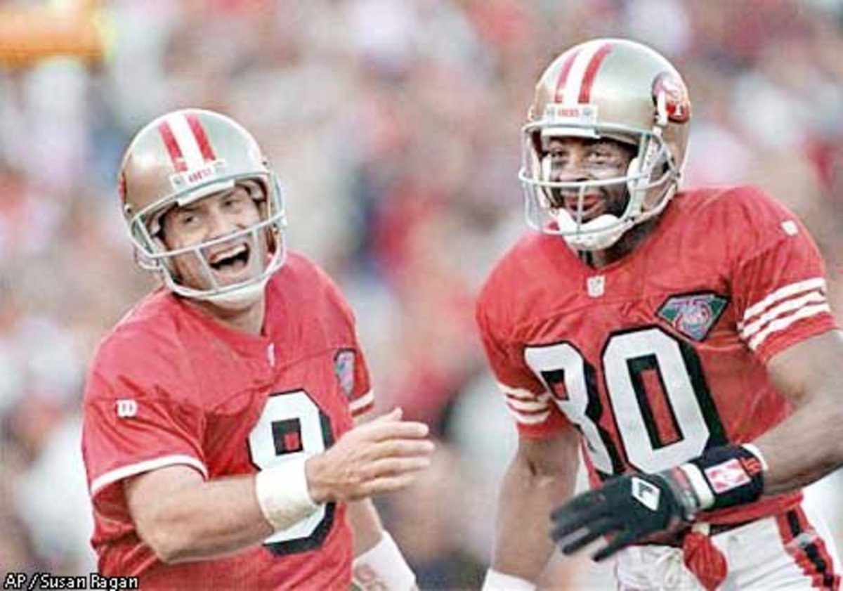 49ers QB Steve Young and Rice rushed to congratulate tight end Brent Jones after Jones scored a touchdown, on November 13, 1994. Associated Press photo by Susan Ragan