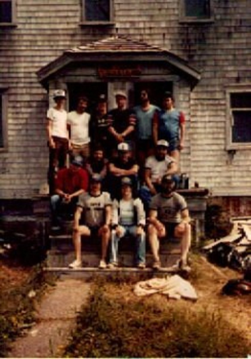 Our 1982 team. That's me. Top row, 2nd from right. Blue cut off sweatshirt , dark hair and beard. Knobby is sitting in the middle with a white baseball cap on