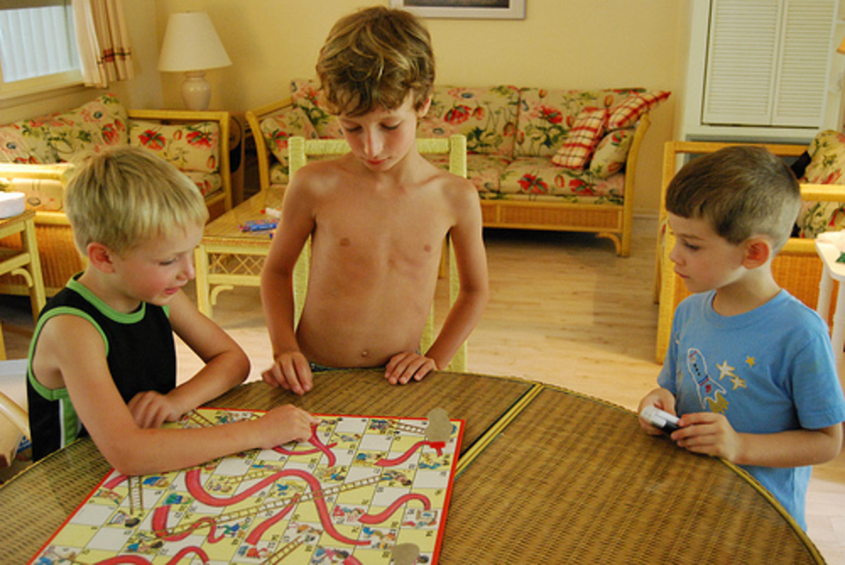 Cooperative play and turn taking with Chutes and Ladders.  Photo from Flickr.com.