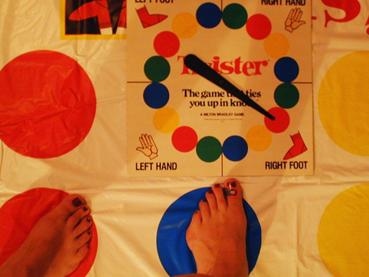 Twister gross motor challenge of motor planning, position in space and proprioception.  Photo from Flickr.com.