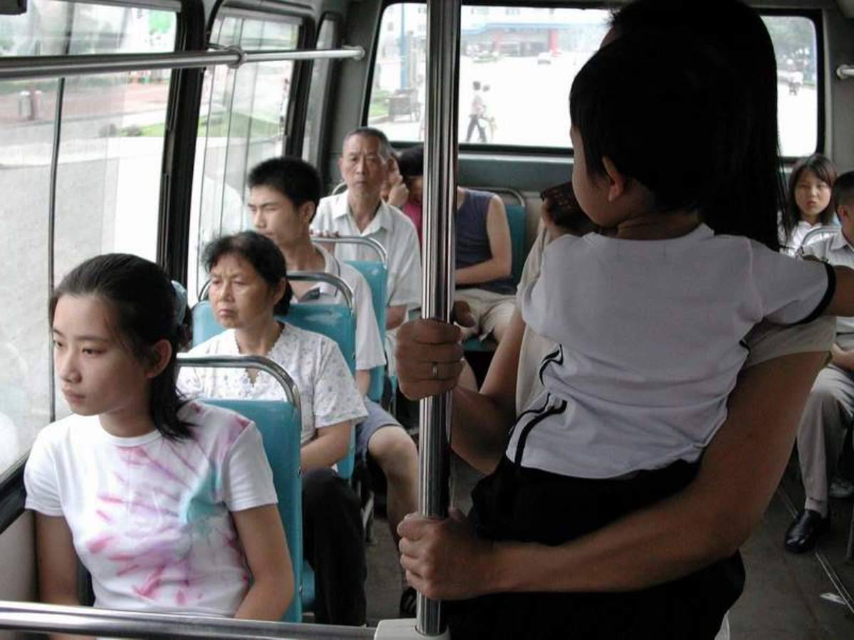 WOMAN WITH CHILD NOT OFFERED BUS SEAT IS AN ETIQUETTE NO NO