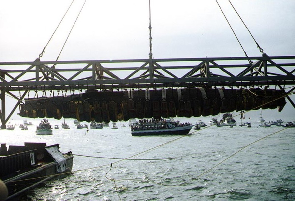 Hunley suspended from a crane after its discovery