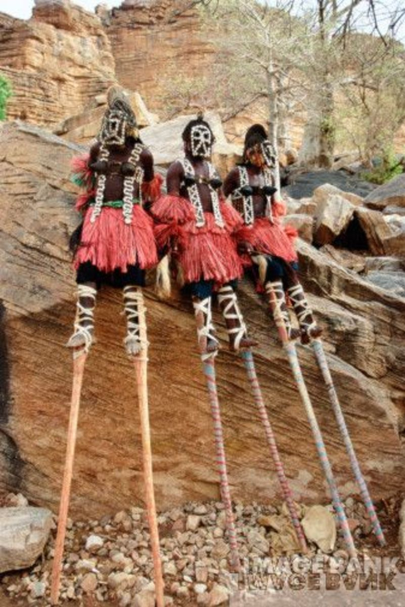 In Mali, Bandiagara Escarpment, the Dogon people rest-up while performing on stilts.