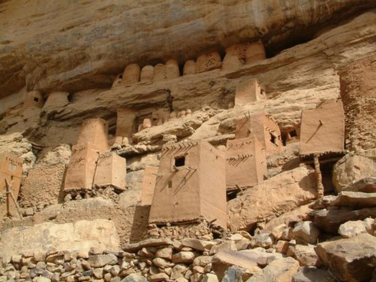 Pygmy houses built into the cliff and granaries by the Pigmy's and later by the Dogon