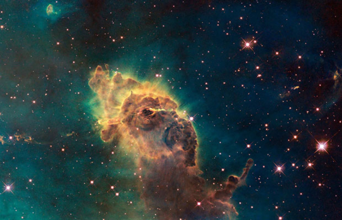 Hubble's first images of visible image of the Carina Nebula. It is composed of gas and dust and the pictured pillar resides in the tempestuous stellar nursery in the Carina Nebula, located 7500 light years in the southern constellation of Carina. Thi
