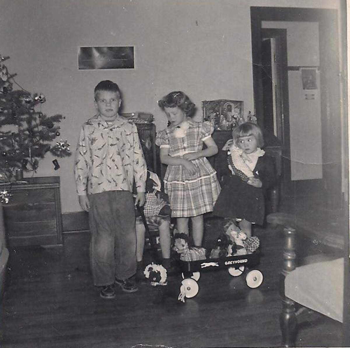 Here I am with all my siblings with our homemade gifts. What a happy Christmas we had. Mom made me a new dress and some stuffed toys for my sisters.