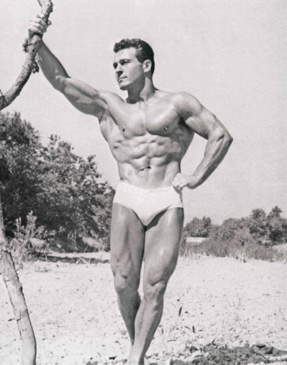 Jack LaLanne at age 40 - tons of muscles in white swim suit
