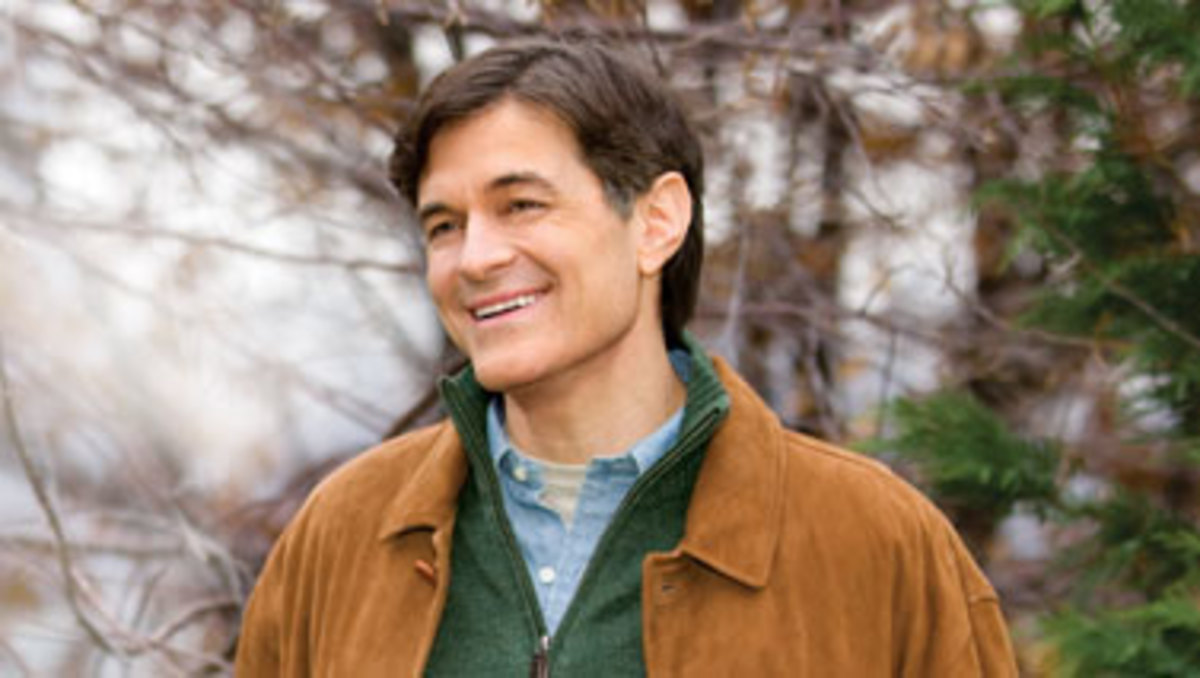 Dr. Mahmet Oz smiling in casual dress suede jacket green and blue shirts