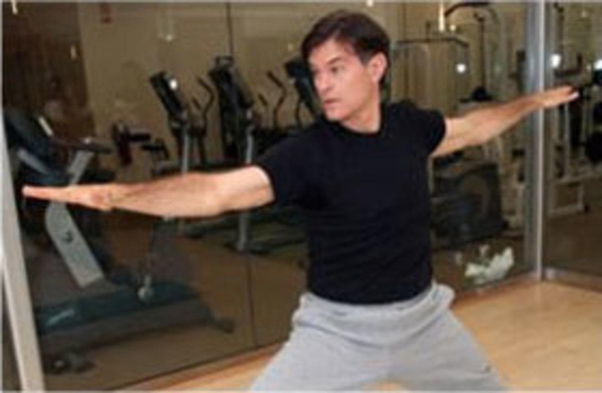 Dr Mehmet Oz in an active pose