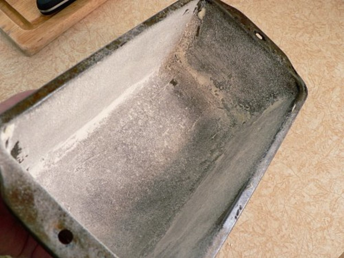 "A bread pan that has been ""floured"" to allow the easily removal of a freshly baked loaf of bread."