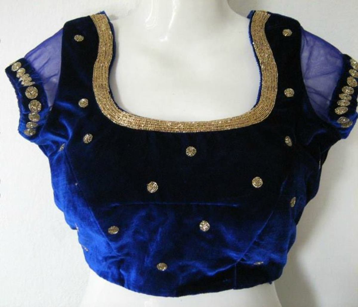 Navy blue velvet blouse.