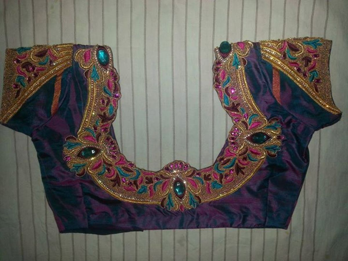 An intricate neck design for a party sari blouse.
