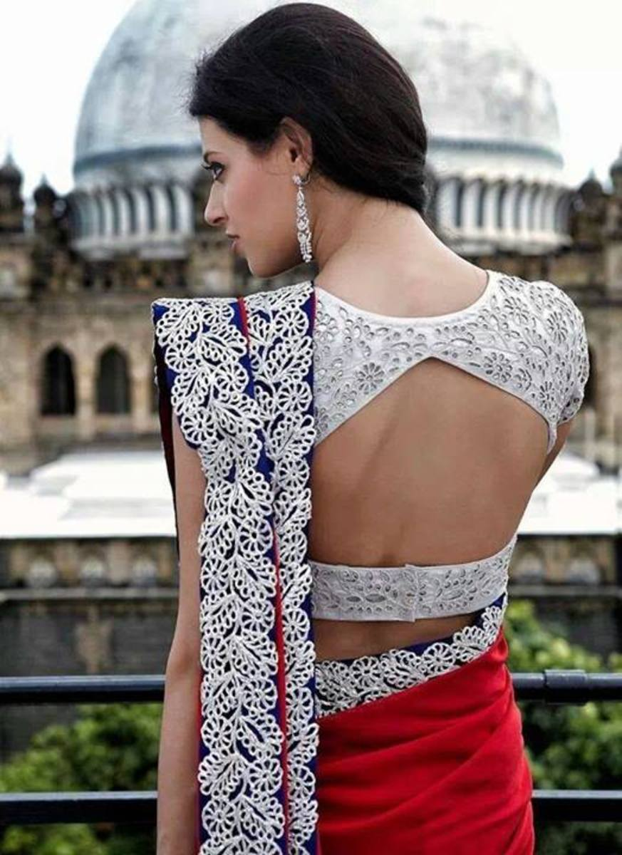 A big window back blouse for the saree.