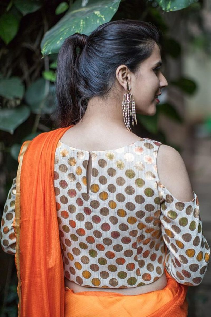 Cold shoulder brocade blouse with orange saree