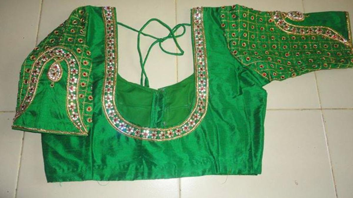 Green elbow length saree blouse.