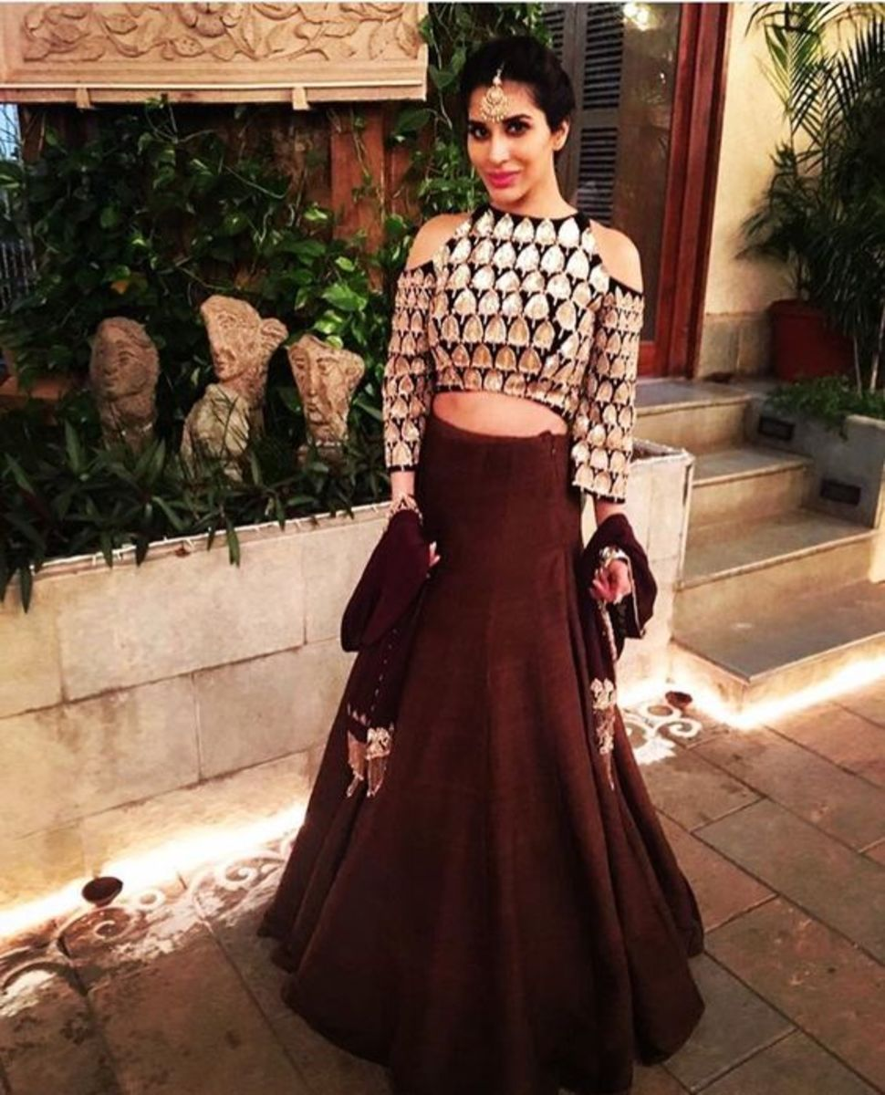 Cold shoulder blouse can be worn with both sarees and lehengas