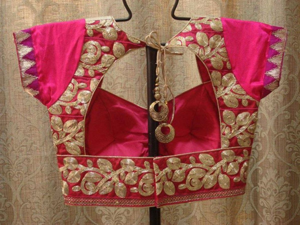 Beautiful and gorgeous hot pink blouse with a window back. Zari embroidery for the ultimate party look.