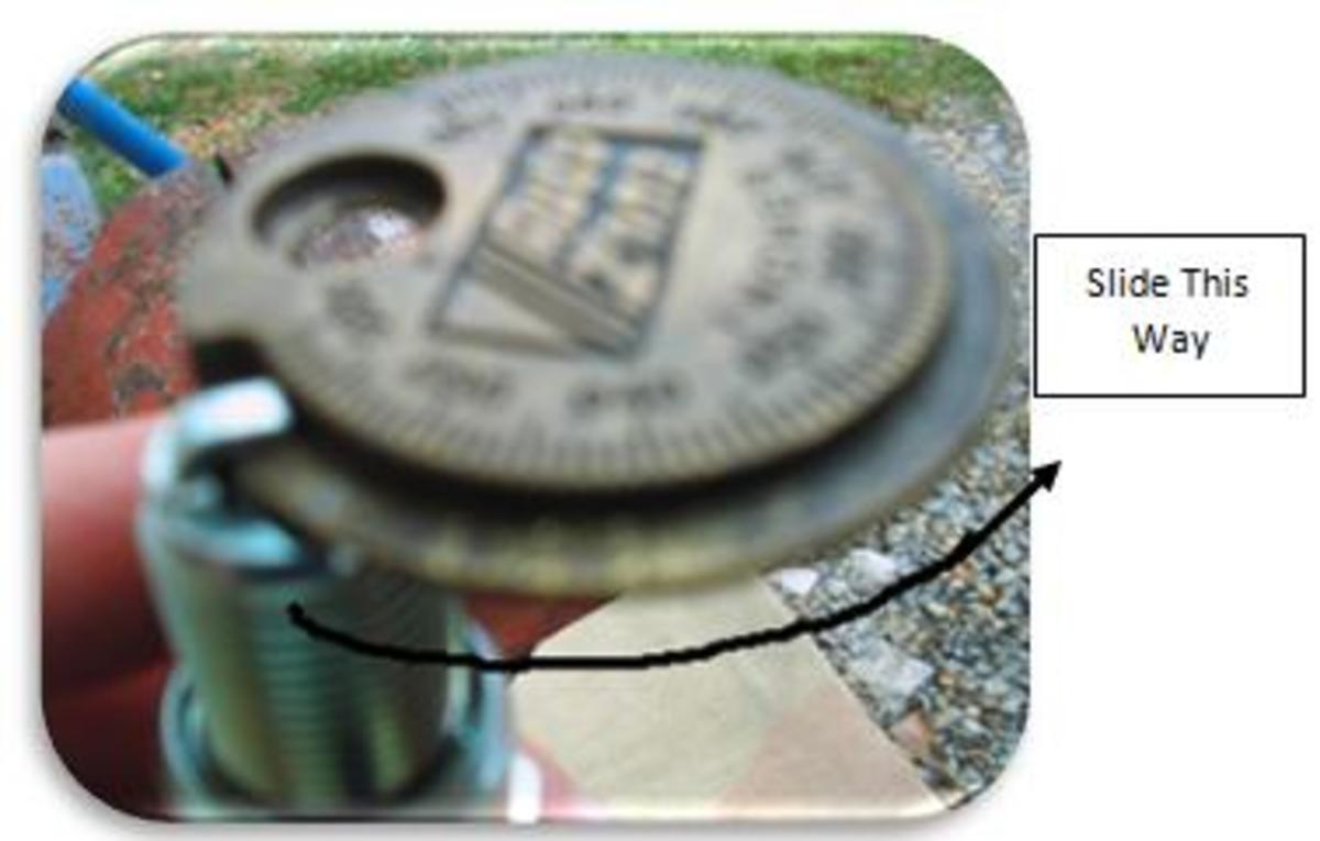 Figure 10 - Spark Plug on Gap Setter